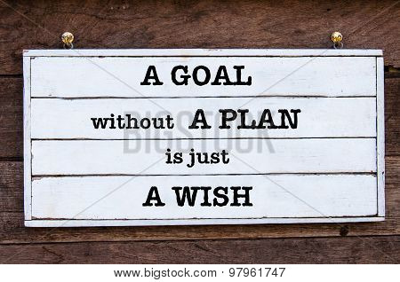 A Goal Without A Plan Is Just A Wish Inspirational message written on vintage wooden board. Motivational concept image poster