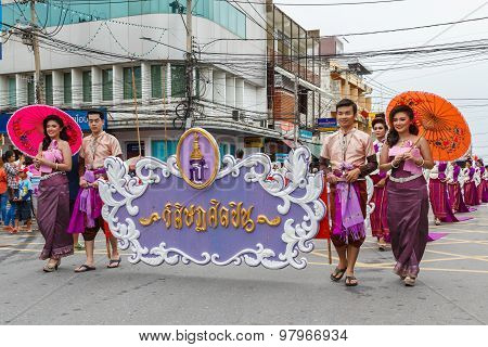 NAKHON RATCHASIMA, THAILAND - JULY 31: Thai people participate parade in grand of opening the traditional candle procession festival of Buddha, on July 31, 2015 in Nakhon Ratchasima, Thailand.