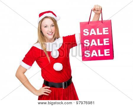Christmas party dressing girl with shopping bag showing three sale word