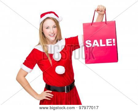 Christmas party dressing girl with shopping bag showing a word sale!