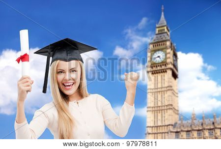 education, school, knowledge, graduation and people concept - happy student girl or woman in trencher cap with diploma certificate over big ben tower in london background