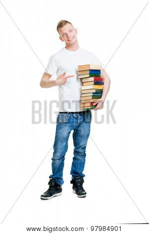 Pupil holding a stack of books isolated on white