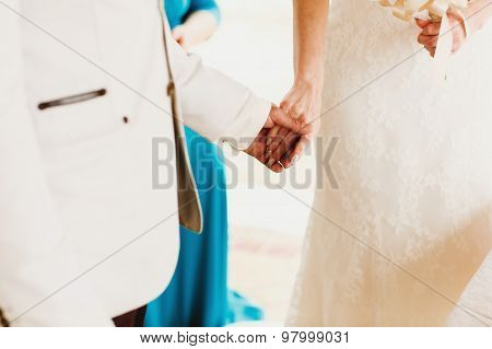Beautiful  Gorgeous Blonde Bride With Orchids And Stylish Groom Holding Hands, Hawaii