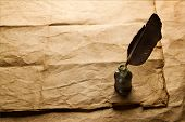 quill pen and inkwell on vintage paper background poster