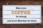 May Your Coffee be strong and your Monday be short message written on vintage wooden board. Motivational concept image poster