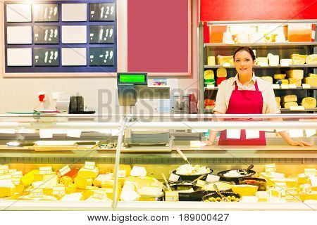 sales clerk at the dairy counter in a supermarket