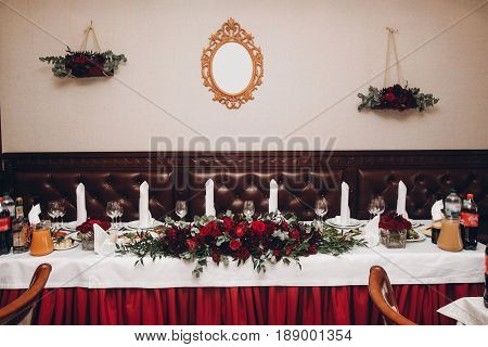 .red Table Centerpiece With Bouquet And Food For Wedding Couple At Wedding Luxury Reception In Resta