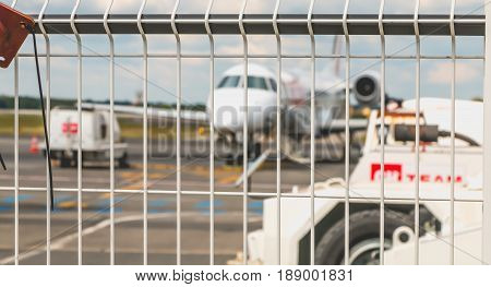 Maintenance Aircraft On The Tarmac Behind A Barrier