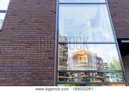 Vilnius, Lithuania - September 30, 2016: Reflection in a glass window of Modern architectural complex of apartment residential buildings. And outdoor facilities.
