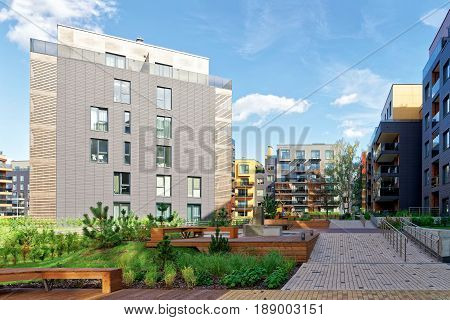 Vilnius, Lithuania - September 30, 3016: Benches at Modern european complex of residential buildings. And outdoor facilities.