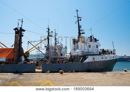 Fishing vessel at pier in old town Sozopol Bulgaria