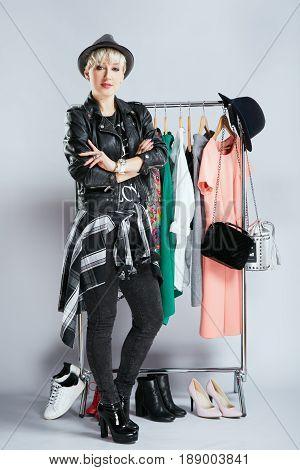 Stylist Examining Clothes