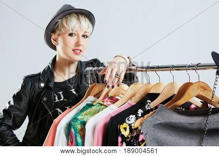 Stylist Near Dresses On Rack