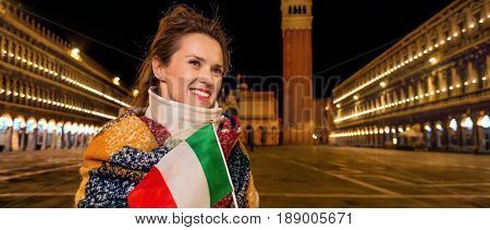 Woman With Flag Near St Mark's Campanile Looking Into Distance