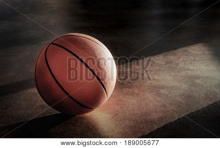 Basketball lay on the floor in a lonely atmosphere.