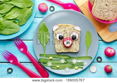 Pig sandwich - creative idea for kids lunch fun animal sandwich shaped pig with bread and vegetables