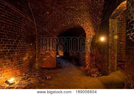Dungeon under the old Prussian fortress illuminated by candles, Kaliningrad, Russia