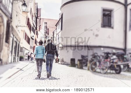 Senior couple walking through the streets of Tuebingen, Germany