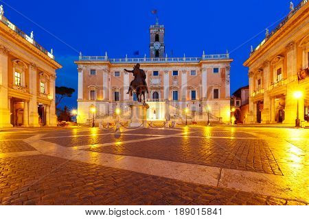 Piazza del Campidoglio on the top of Capitoline Hill with the facade of Senatorial Palace and equestrian statue of Marcus Aurelius at night, Rome, Italy