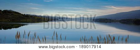 Panoramic Reservoir and Reflections. Crystal Springs Reservoir, San Mateo County, California, USA.