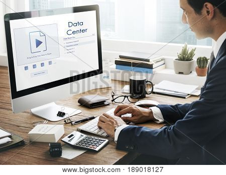 Man sharing uploading a file to cloud storage