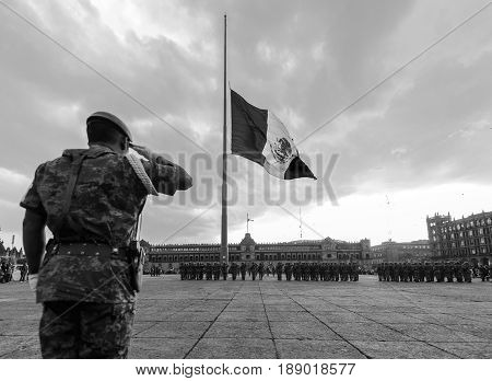 Mexico, Federal District, Mexico City - April 19, 2017: Soldiers and military police performing the daily Flag Lowering Ceremony in the Zocalo