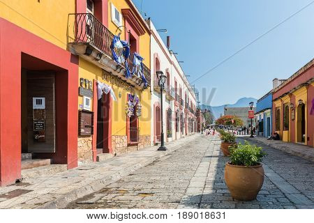 Oaxaca, Mexico - April 17, 2017: Colorful buildings on the cobblestone streets of Oaxaca, Mexico