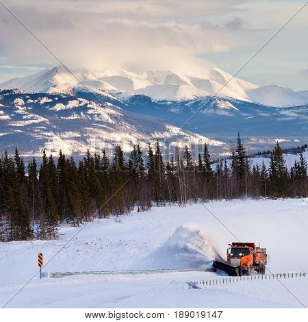 Snowplow Clearing Road In Scenic Yukon T Canada