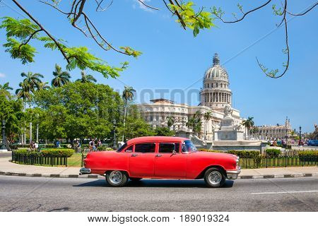 HAVANA,CUBA - MAY 29, 2017 : Classic american car next to the Capitol building in Old Havana