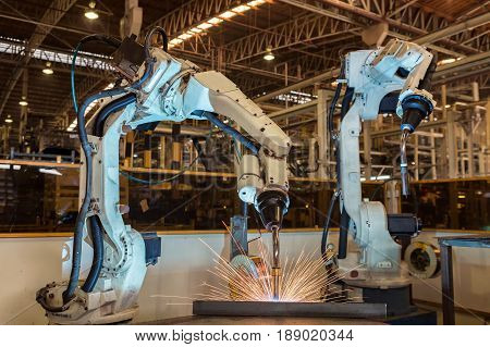 robots are welding automotive part in automotive industrial