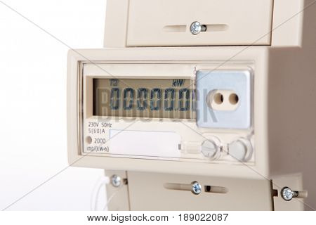 Device for metering of electricity consumption. Electric meter on a white background.