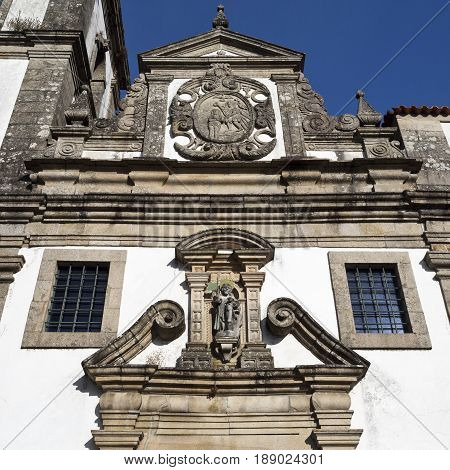 The facade of the parish church of Sao Joao Baptista combines the Mannerist and Baroque styles and a prominence of the Baptism of Christ in Ponte da Barca Portugal