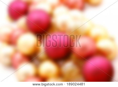 Long row of Christmas ornaments on white - blurred image background