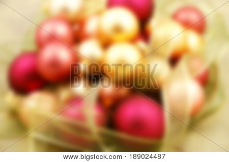 Christmas ornaments on paper surrounded by ribbon - blurred image background