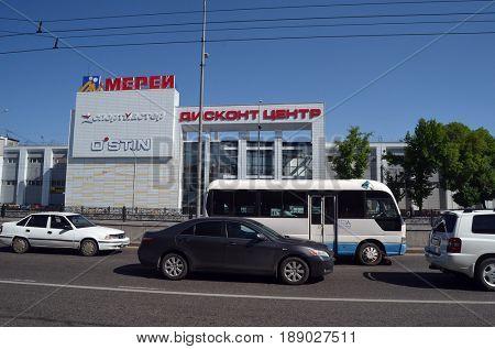 Incription - Merey.Discont center,Sport-master (RU).Street,traffic,transport.Almaty,Central Asia.May 5, 2017.ALMATY, KAZAKHSTAN