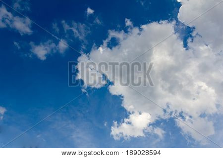 Blue Sky Background With White Clouds. The Vast Blue Sky And Clouds Sky On Sunny Day. White Fluffy C