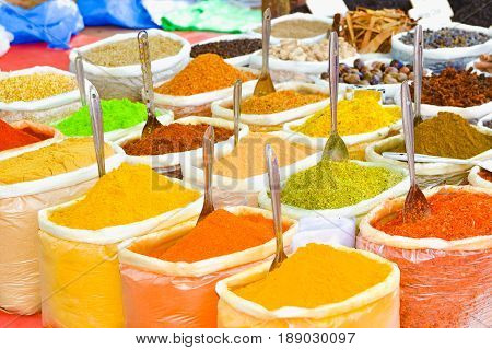 Indian spices in bags at the market in Anjuna