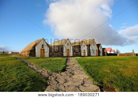 Row of traditional turf houses in Gaumbaer Iceland
