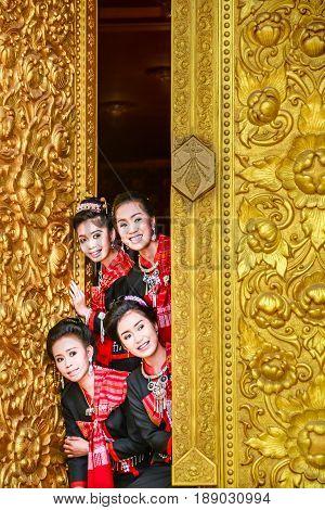 NAKORN PHANOM THAILAND - FEBRUARY 14 2015: Tourist ladies visit and join Thai northeastern Phutai world event day in Renunakorn of Nakorn Phanom Thailand