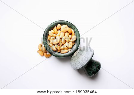 Roasted Cashew Nuts In A Marble Mortar