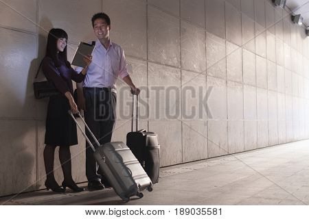 Chinese business people with rolling luggage