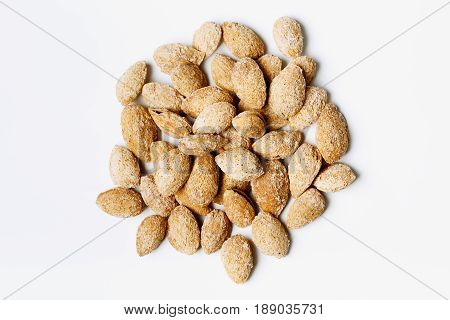 Heap Of Roasted Almond Nuts On White