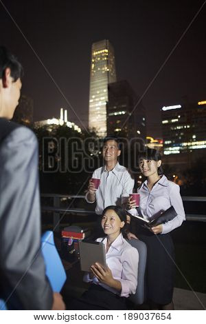 Chinese business people working together at night