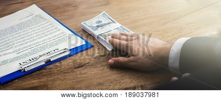 Businessman offering money while making an agreement - panoramic banner