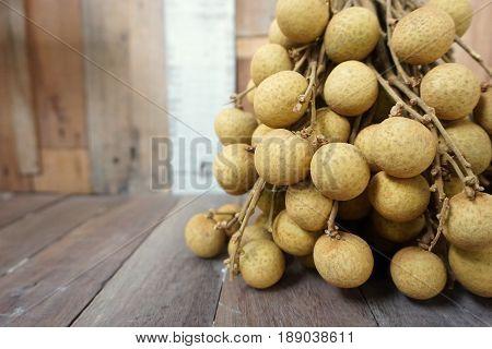 close up group of Longan fruit on the wood background