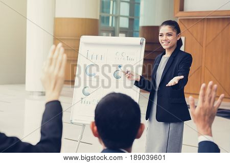Young businesswoman making a presentation and asking for opinion in the meeting