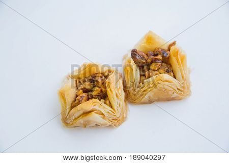 Baklava is a Middle-Eastern dessert. It is a rich, sweet pastry made of layers of filo filled with chopped nuts