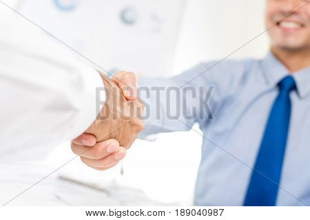 Businessmen making handshake - partnership congratulation merger and acquisition concepts