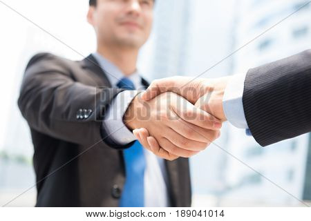 Businessman making handshake - success dealing greeting & business partner concepts