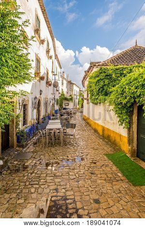 OBIDOS,PORTUGAL - MAY 11,2017 - In the streets of the picturesque town of Obidos. The area of the town of Obidos is located on a hilltop encircled by a fortified wall.